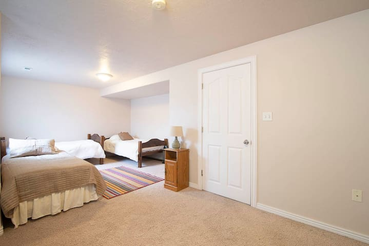 Large room with 4 beds