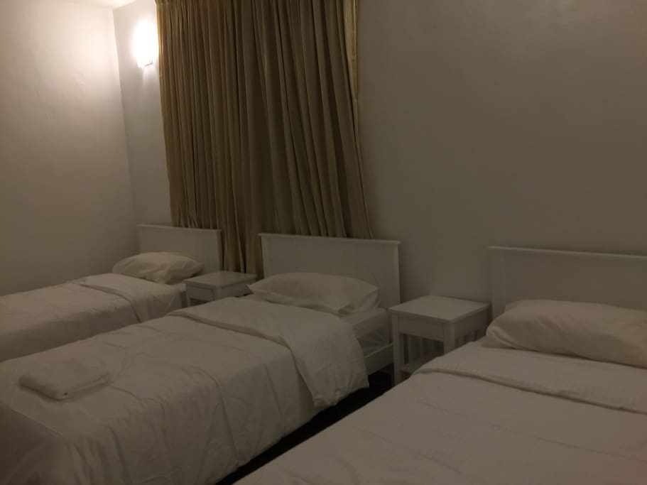 One of the room with 3 super single beds.