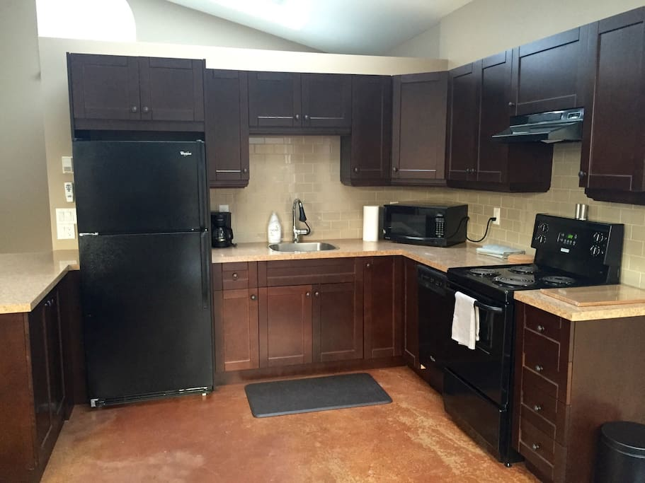 Fully stocked & functional kitchen, ready to use. All pots, pans, cups, plates, coffee machine, kettle, microwave, and utensils are provided.