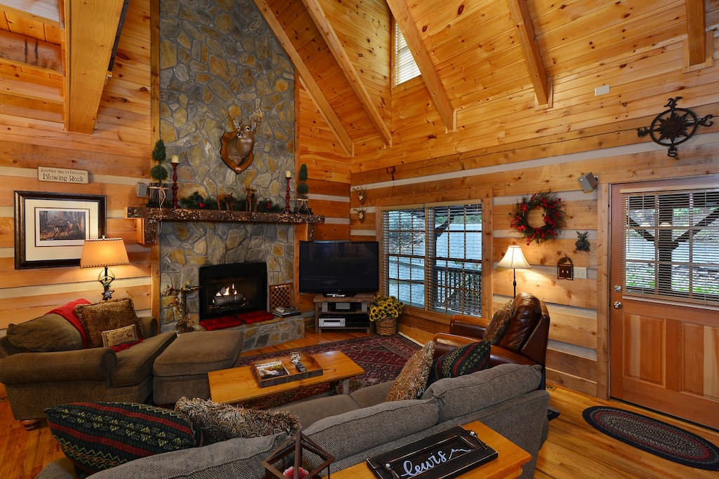 "Open den, 2 story fireplace w/ gas logs, 60"" HDTV, Blu Ray, and surround sound."