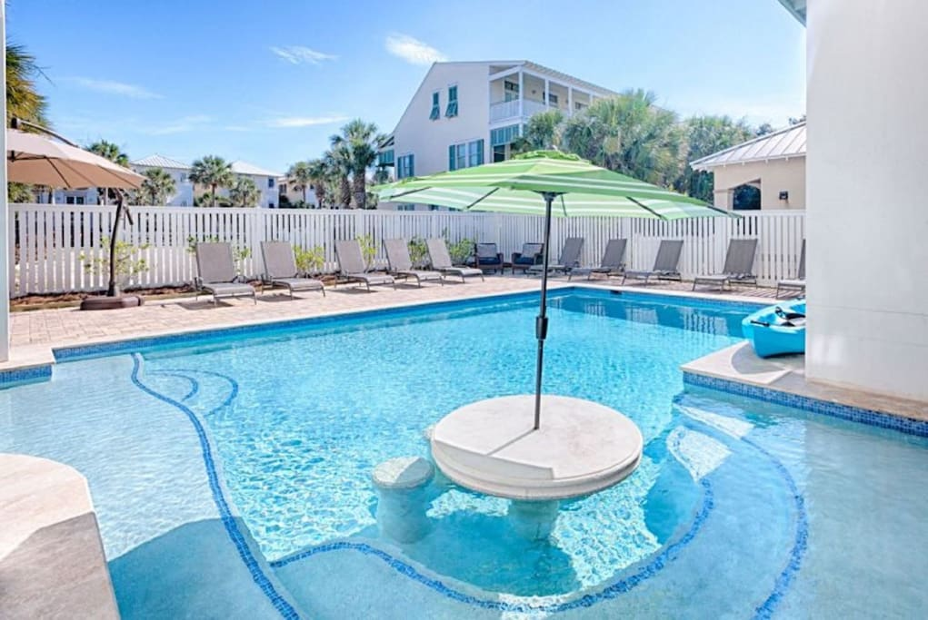 Born To Sun Large Pool Area Featuring An Outdoor Living Area, Gas Grill, Yeti Cooler, Ice Maker, and Plenty of Lounge Chairs