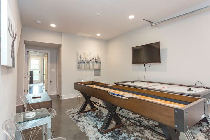Our game room featuring a Shuffleboard, Air Hockey, and TV