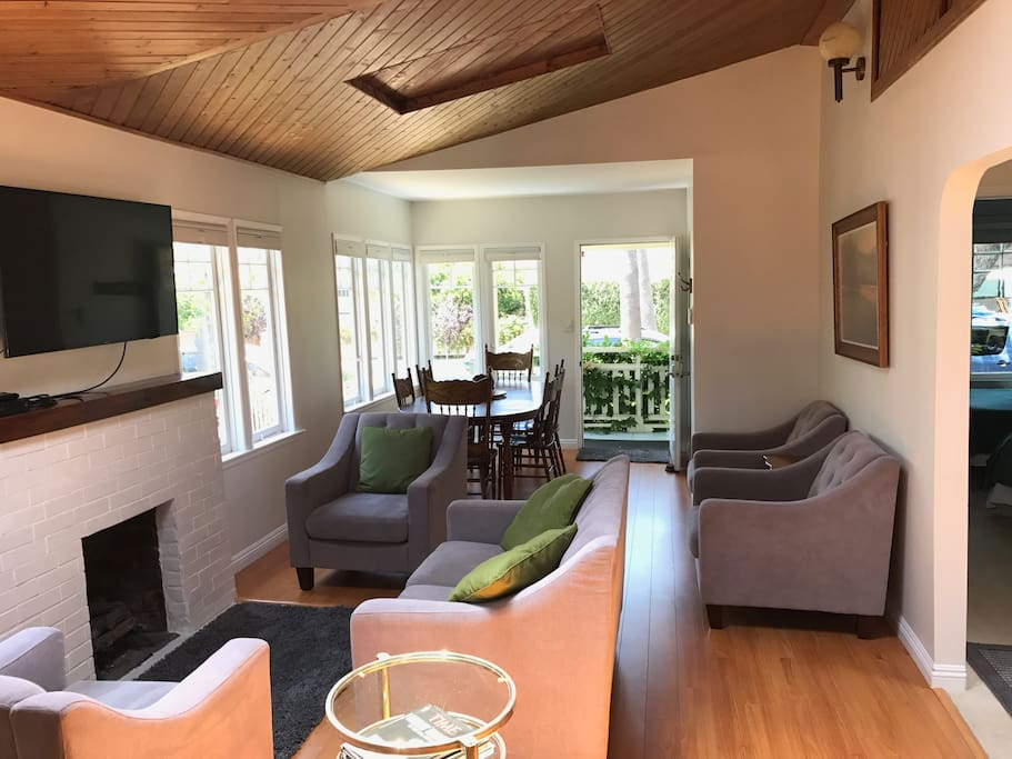 The living room has everything you need for work, relaxing, lounging, or socializing. The elevated wood paneled ceilings gives the room a feeling of ample space and freedom.