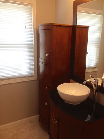 Vessel sink and nice cabinet storage for personal belongings