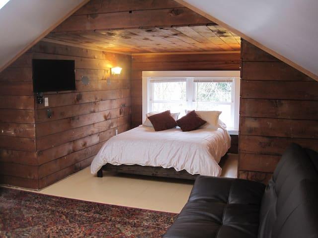 Queen bed with memory foam mattress in dormer nook.
