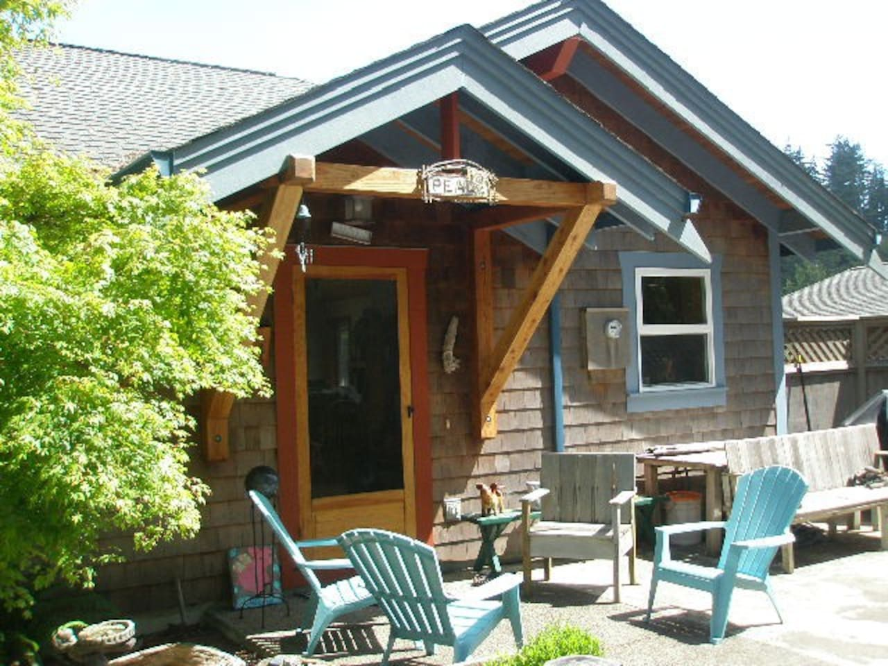 The front entrance to the house. Sunny patio with seating, Gas BBQ