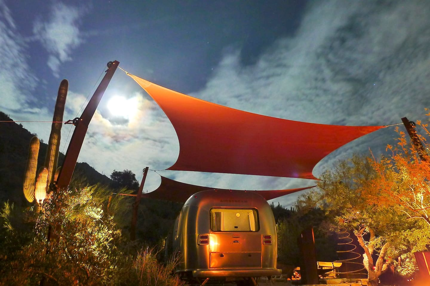 28 ft Airstream CCD under architecturally designed shade structure & landscape lighting to bring the desert to life after dark.