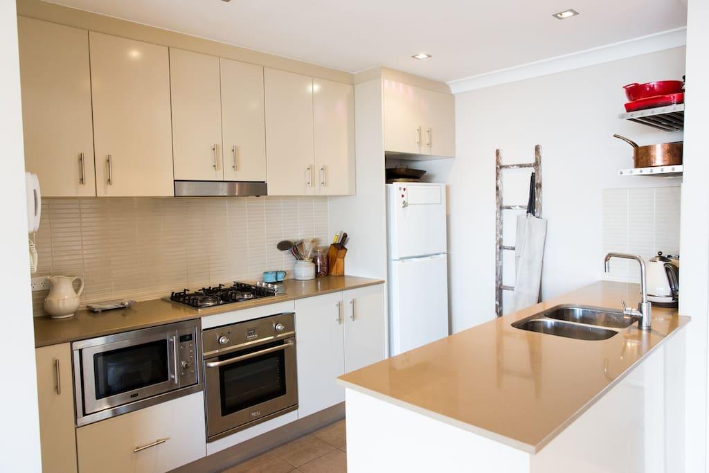 Kitchen - gas stove, oven, microwave, dishwasher & fridge