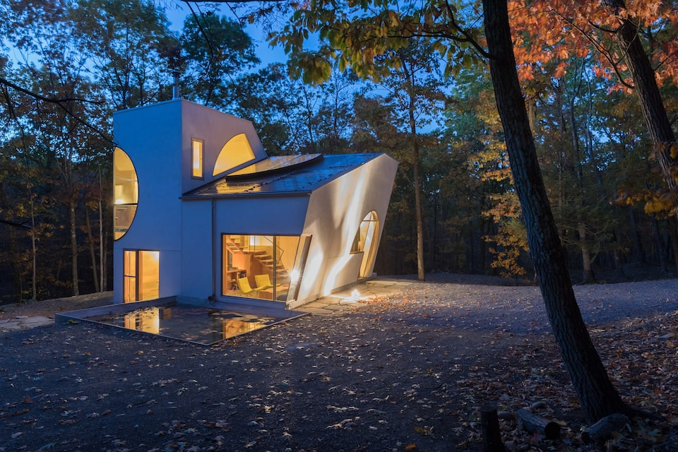 Architectural wonder in the woods, an AirBnB destination for travelers.