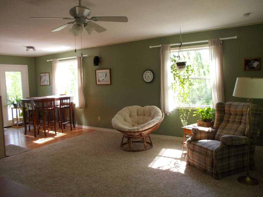 Great room is very spacious and has large windows facing three directions and an in-wall stereo system.