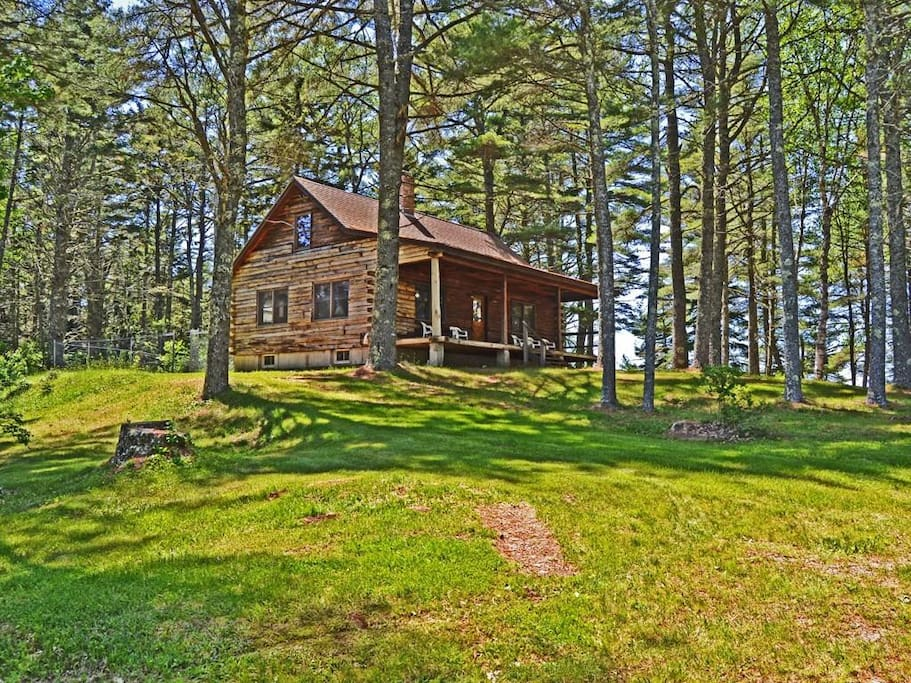 Log Cabin with 3 bedrooms, open living space and full bath.