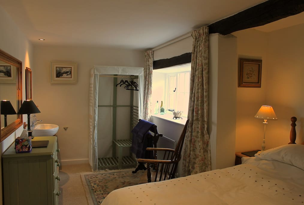 Pretty beamed double bedroom, wash-basin, amazing views across valley.