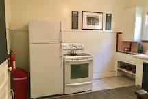 Kitchen with Five Burner Stove and Fridge
