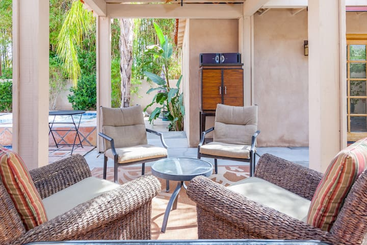 Comfy patio seating area with stereo cabinet just steps from your suite.