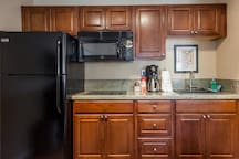 Modern equipped Kitchenette with 18 cubic ft. refrigerator with auto ice maker.