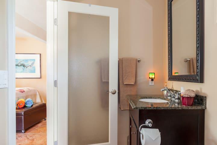 Private on suite bathroom with granite vanity.