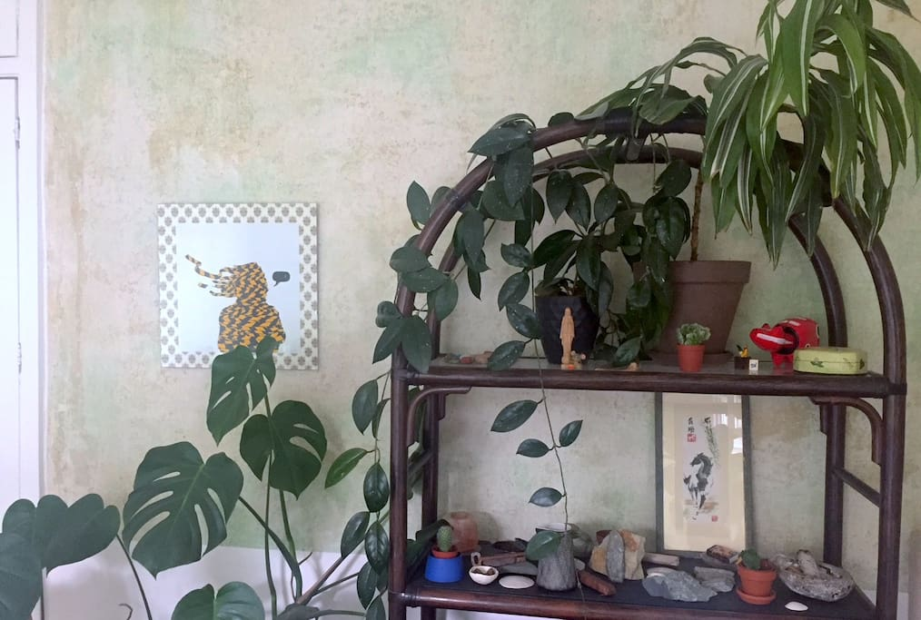 Bedroom detail. The apartment is full of plants.