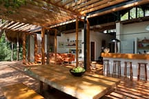 Living, kitchen and outside dining areas