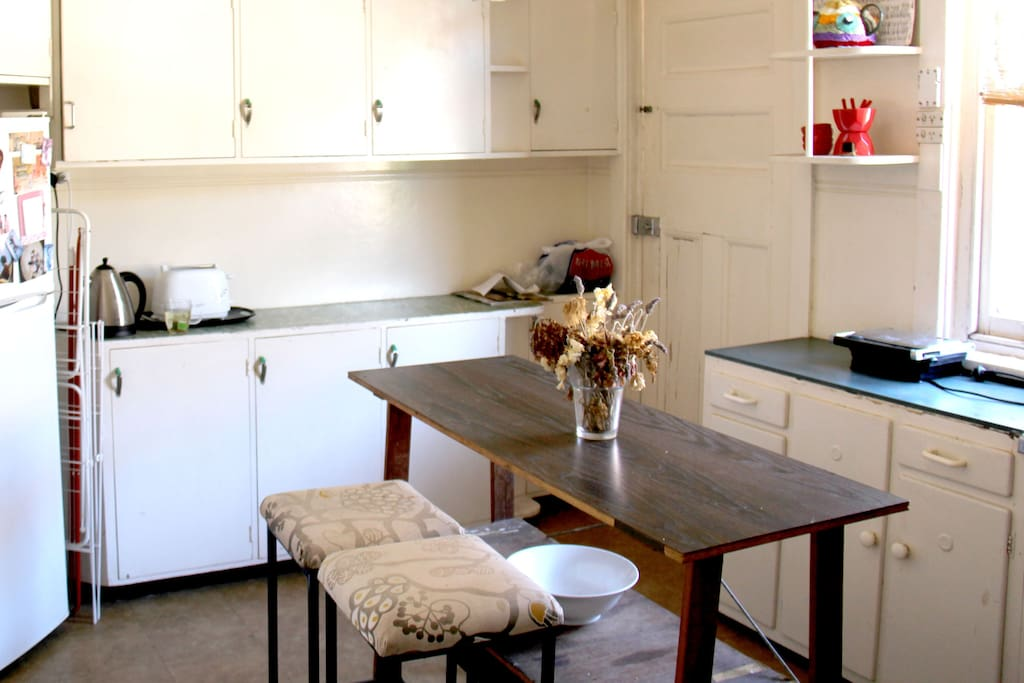 Retro Style Kitchen with oven, stove, kettle, sandwich press and fridge