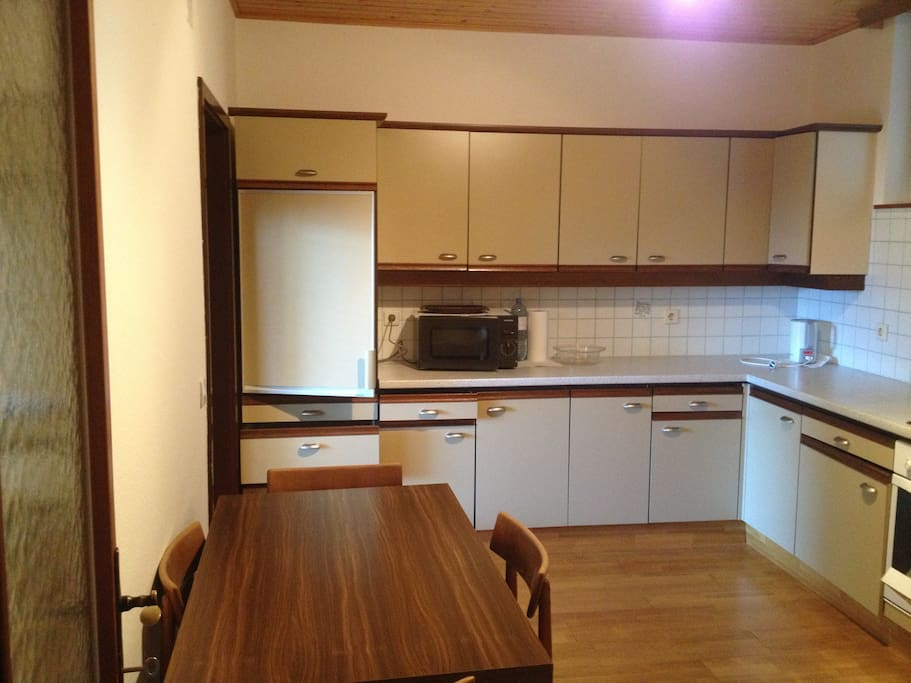 Large fully-equipped kitchen with breakfast table.