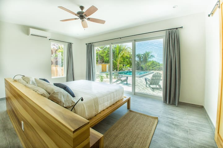 Master bedroom over looking pool and private garden. Ocean views in the distance.