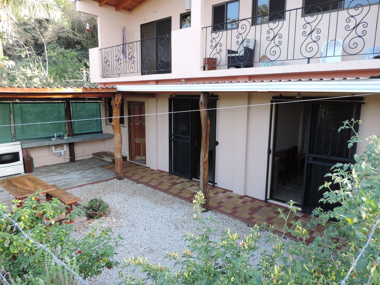 Newly constructed apartment in 2-Unit building on a side street in a safe and secure area.  Apartment has private bathroom and shares a covered, outdoor Kitchen with other Unit.  Courtyard is also shared.