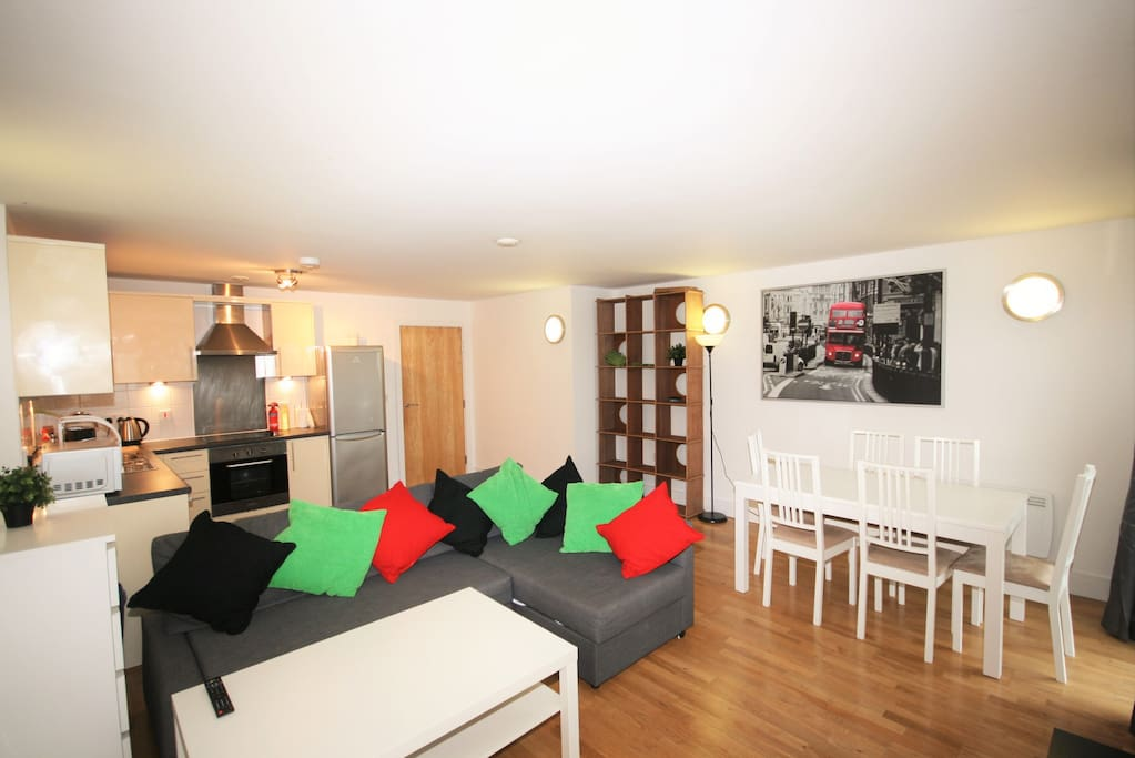 Large Open Plan Kitchen/Lounge/Diner with Private Balcony, 6 chair dinning table, sofa bed sleeps two, TV.