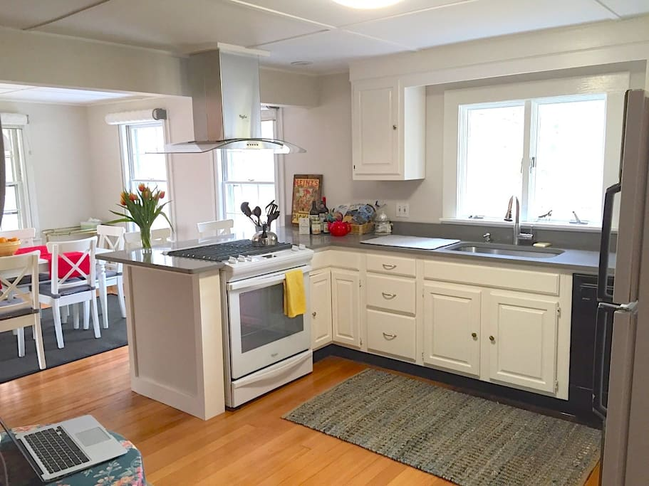 A spacious kitchen opens into the dining room and looks out onto a private deck and backyard.