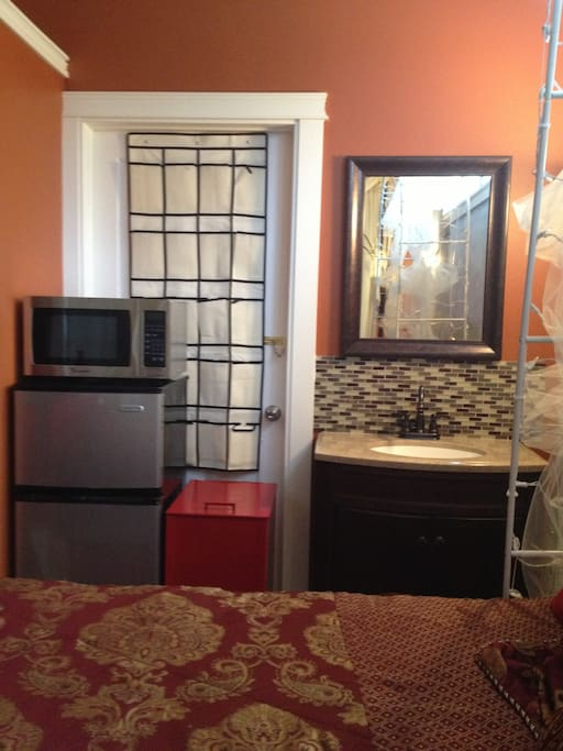 RED ROOM OR ROOM # 9, WITH SINK, MIRROR, REF. & MICRO, SHOE ORGANIZER, FILE CABINET WITH LOCK DOOR FOR SAFETY