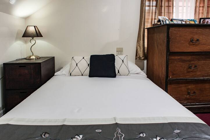 Double sized bed in the bedroom loft