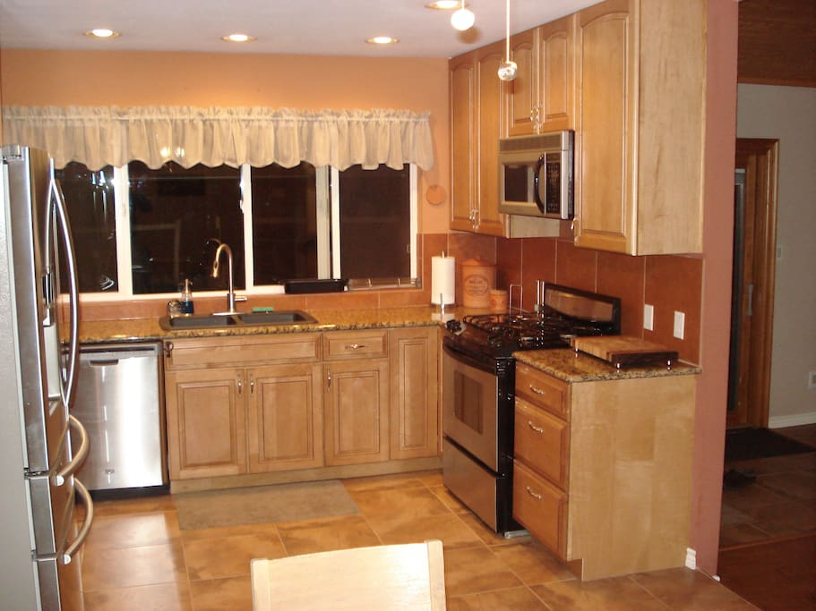 Kitchen with gas stove, garbage disposal and dishwasher