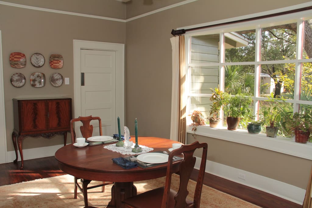 Dining room with its bay window gives you lots of sunshine and our native plant garden