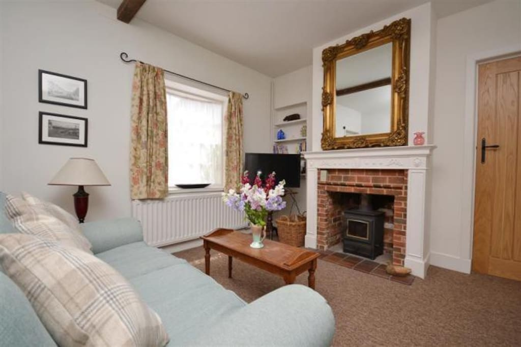 Sitting room with wood burning stove and sofa bed
