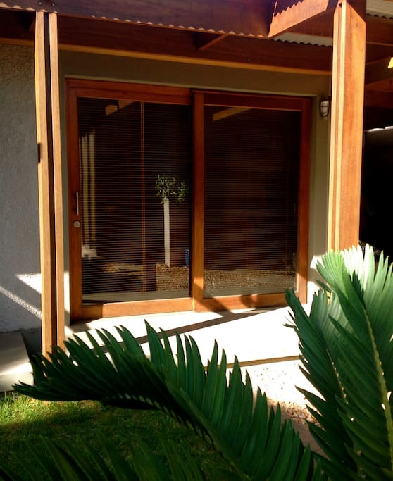 Private Entrance with access to communal Garden, Pool and BBQ