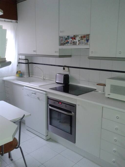 kitchen with all electrodomestic equipment.
