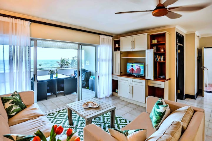 Modern Beachfront Apartment with Breaker views