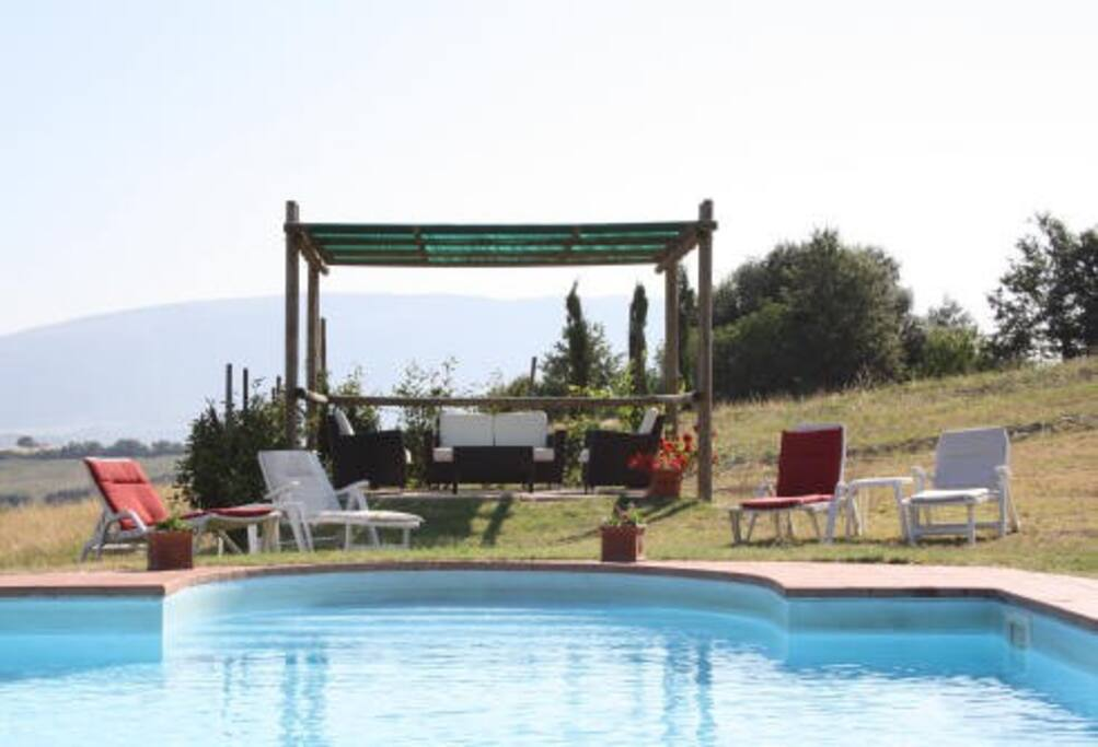 beautiful swimmingpool, gazebo with comfortable sit.