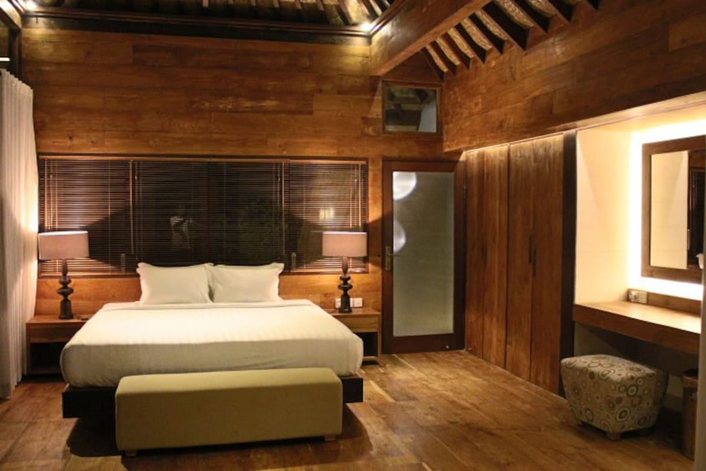 Master bedroom with king bed, built-in desk, ensuite bathroom, built-in wardrobe, private deck suitable for small yoga