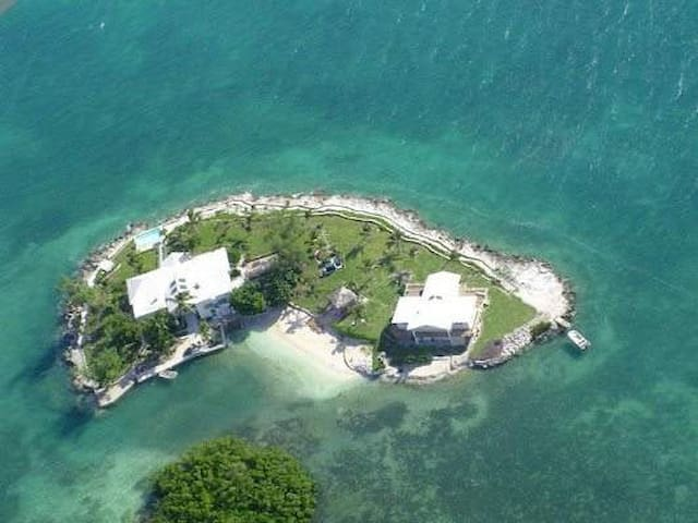 Private island-easy access airport ELH sleeps 19