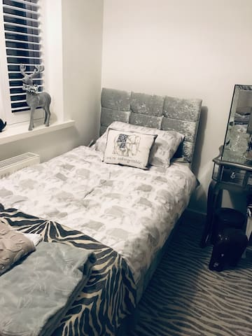 Recently decorated room with two crushed velvet single beds and shutters in the windows.  There is hanging space and free wifi and tv with amazon fire stick