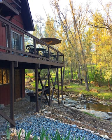Nestled above a gentle creek that winds through the property in the springtime