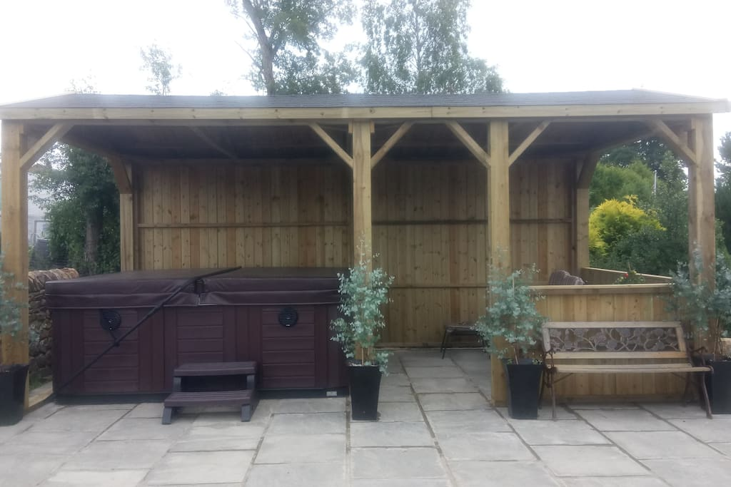 Covered hot tub and seating area