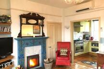 Open plan well equipped kitchen with Boretti large stove/oven, combi microwave,