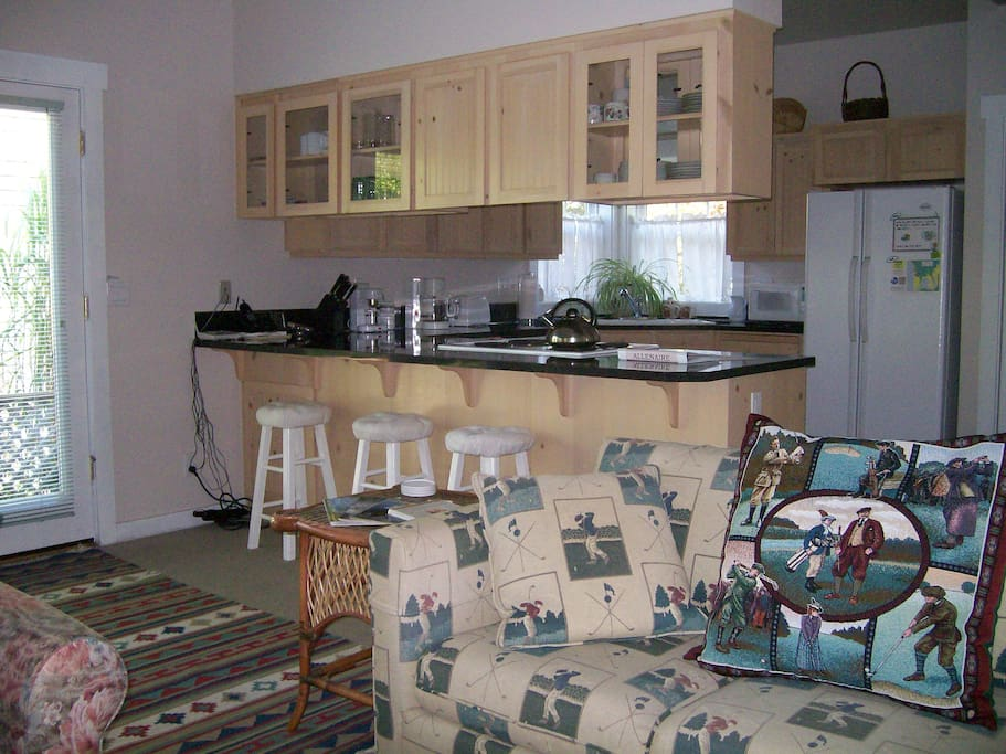 Fully equipped kitchen open to living/dining area.