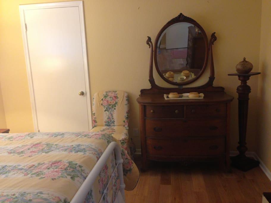 Nice wood dresser with plenty of storage and mirror