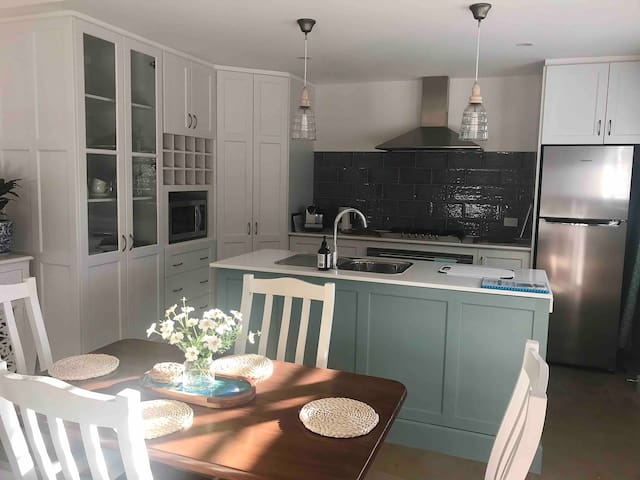 Fully functional kitchen with oven, cooktop, full sized fridge, microwave & dishwasher.