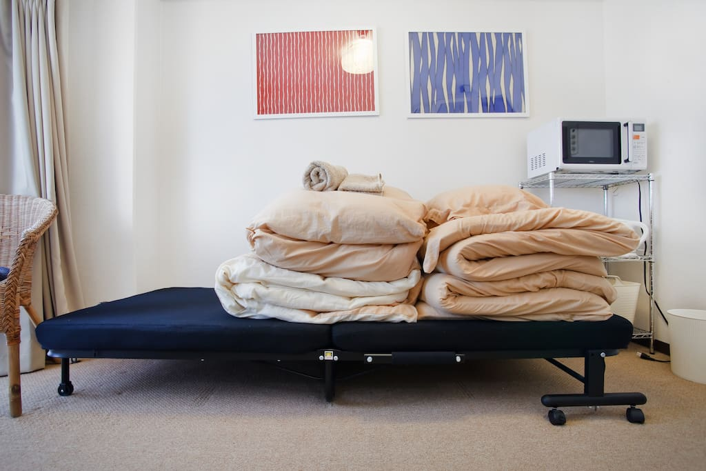 Two pairs of futon and folding beds