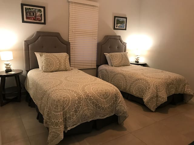 third bedroom with twin beds and closet space
