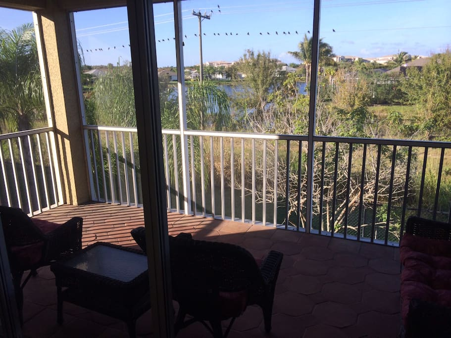 Screened in patio seats 4-5 comfortably! Why not have breakfast, lunch or dinner outside! Enjoy the water view.