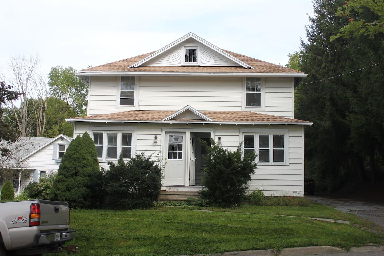 Frontview of Townhouse. Door open is Apartment A